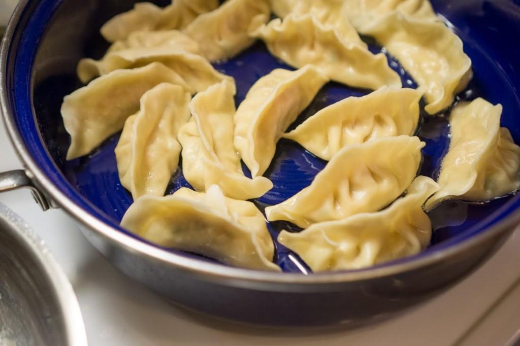 Pan-frying the parboiled dumplings