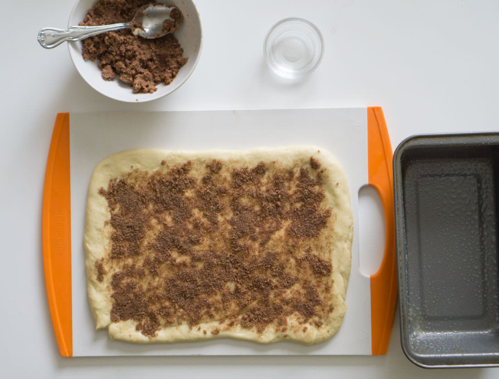 Japanese milk bread dough, patted out and topped with cinnamon-sugar topping