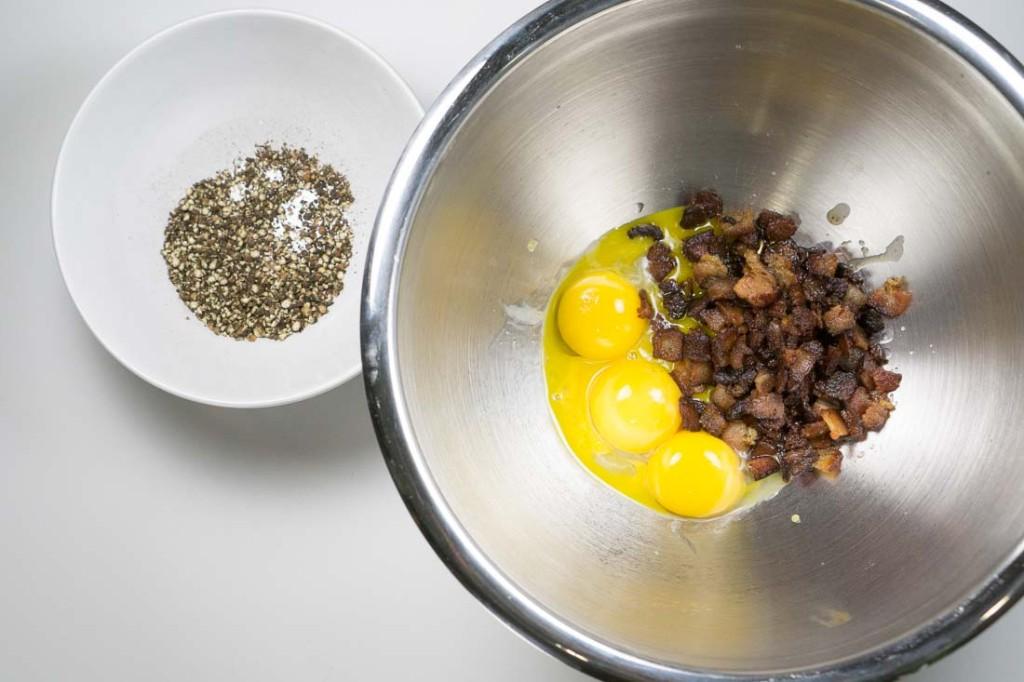 Pepper, yolks, bacon -- a delicious trifecta.